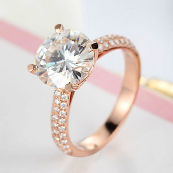 Round Cut 1 Carat Solitaire With Side Accent Moissanite Rings In 18K Rose Gold